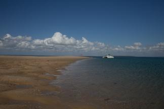 Blue sky, white sand.