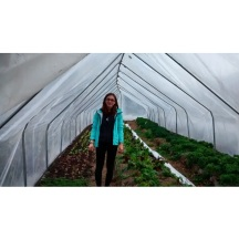 Standing inside one of the high tunnel hoop houses.